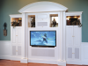 Built-in media cabinet with white lacquer finish.