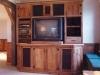 Media cabinet of barn wood.